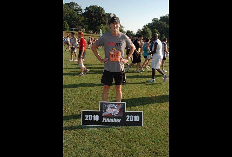 Dr. Pate posing with finisher sign