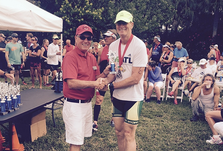 Dr. Pate shaking hands with someone after race