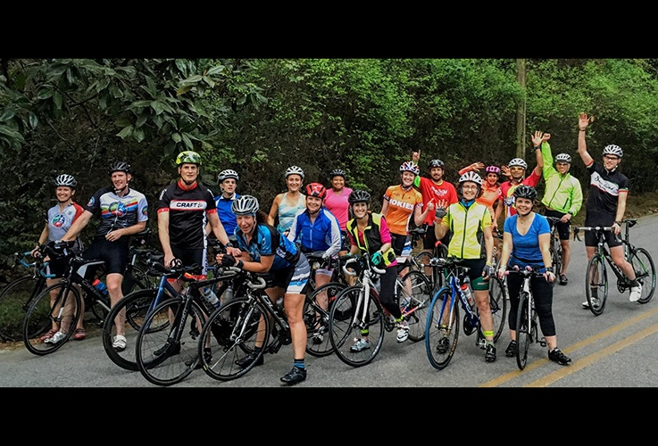 Dr. Pate and large group of cyclists