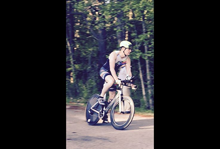 Dr. Pate riding bike in woods