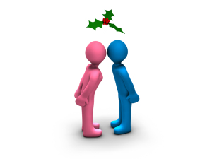 boy and girl kissing under the mistletoe